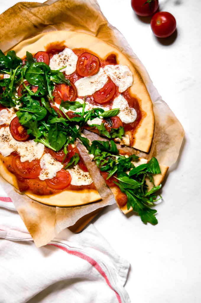 Tomato and arugula pizza with tomatoes