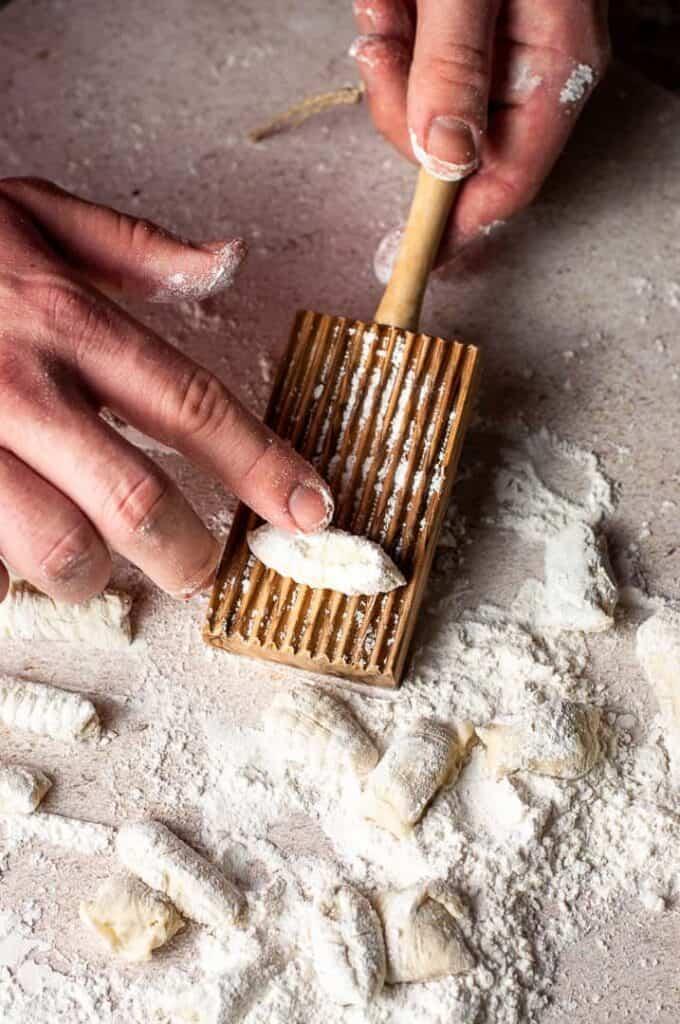man rolling homemade gnocchi