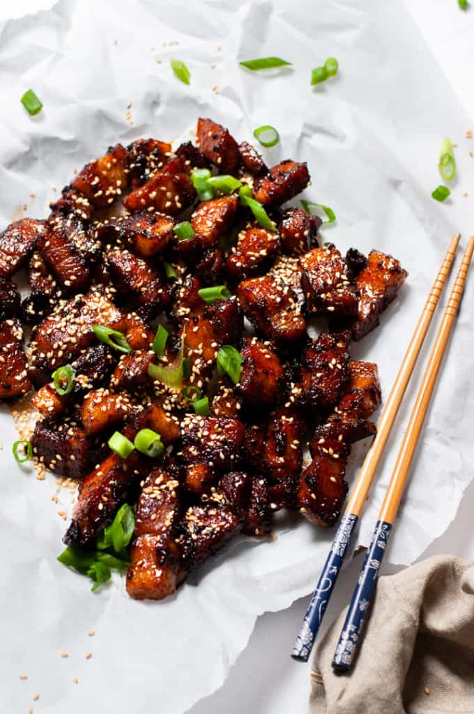 Pork belly with sesame seeds and scallions