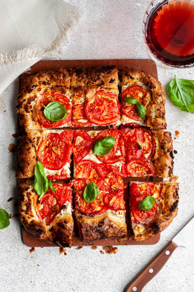 Whipped goat cheese and tomato tart with basil and wine