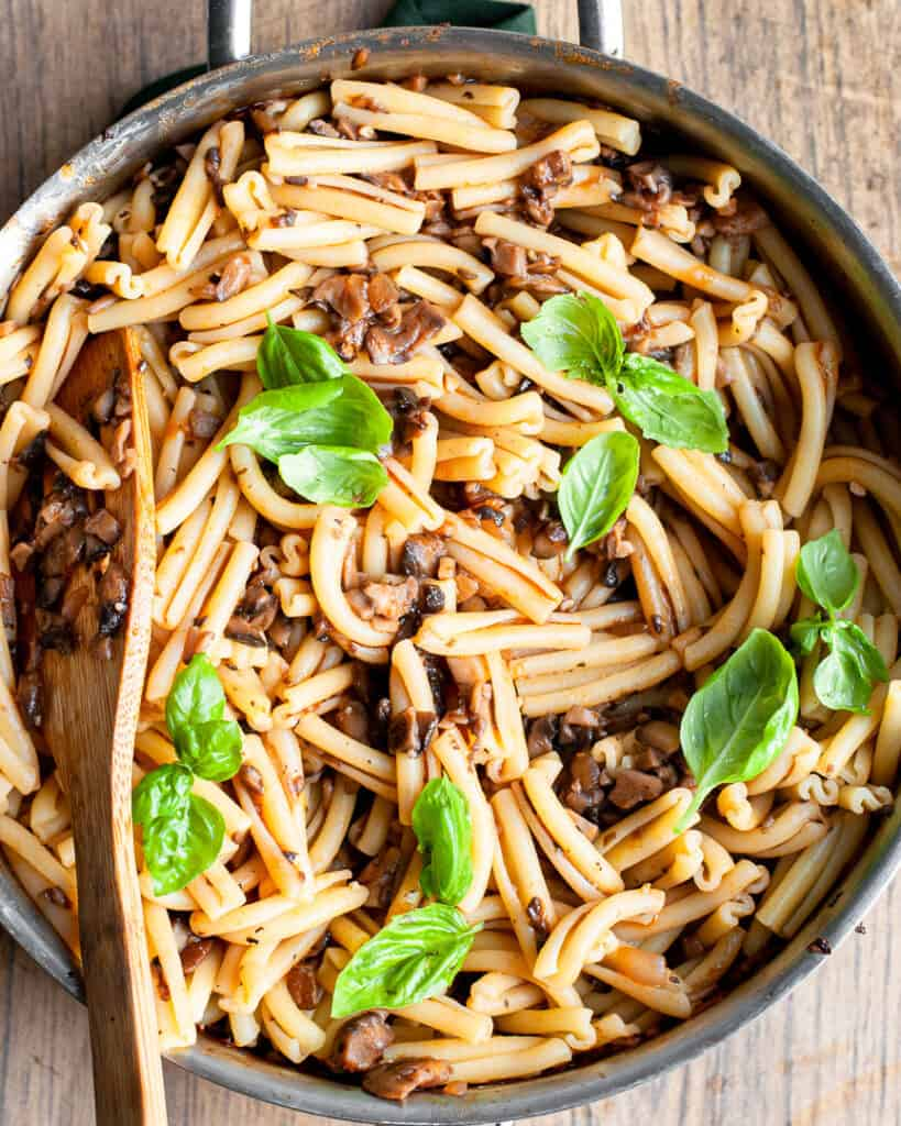 Easy Vegetarian Portobello Mushroom Bolognese in a pan with a wooden spoon