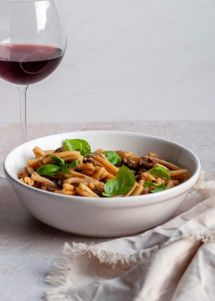Vegetarian Portobello Mushroom Bolognese with a glass of wine