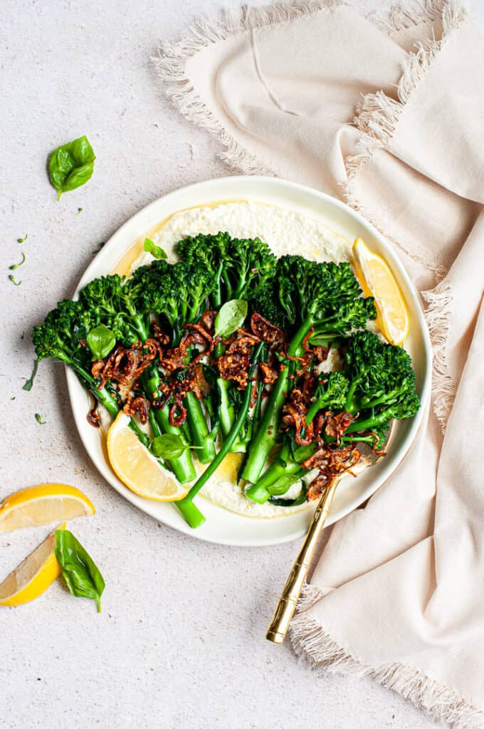 Goat cheese, Broccolini, Shallots, lemons on a plate with a napkin